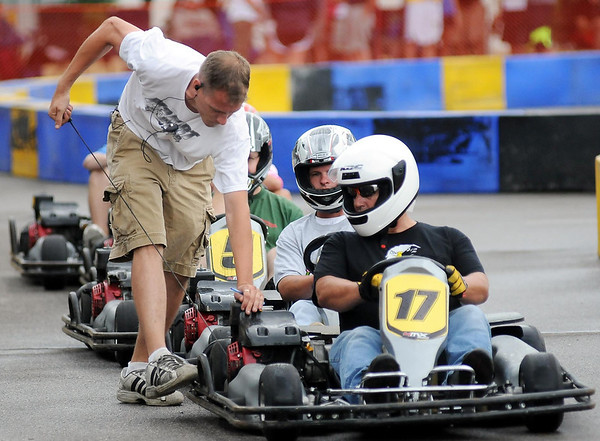 Racers get their go-kart engines started by race officials for the start of their heat of the MRCI Grand Prix, Saturday.