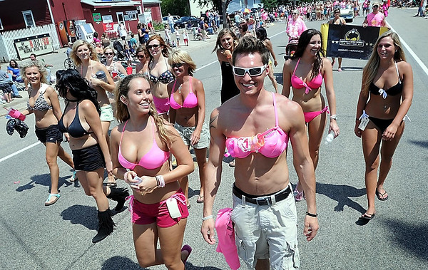 John Cross<br /> Bikini-clad participants stroll along the Paddlefish Days parade route Saturday in Madison Lake. Organizers had hoped to entice 450 people to don bikinis as a fund raising effort for breast cancer research and also to break a world record for the most bikini-clad marchers. About 100 showed up.