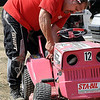John Cross<br /> Riding lawnmower racer Dave Stratton of Burnsville makes some adjustments on one of his machines.