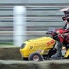 John Cross<br /> A racer speeds along the track straightaway during riding lawnmower races Saturday at the Blue Earth County Fair.