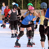 Gretchen Clyde weaves through fellow roller derby teammates during practice Tuesday.