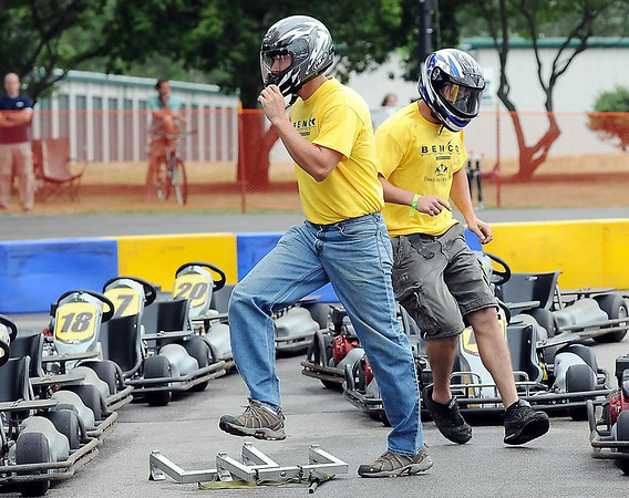 Benco race team members hurry to change drivers during a heat of the MRCI Grand Prix, Saturday.