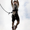 John Cross<br /> Joseph Witte will come up just short on his leap from a pole 30 feet above the ground to grab a trapeze while particpating Monday in a YMCA Adventure Camp session at the MSU ropes course.