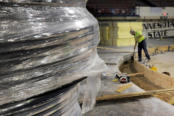 John Cross<br /> Coils of tubing await installation in what will become the  new refrigeration system of the new rink at the Verizon Wireless Center.