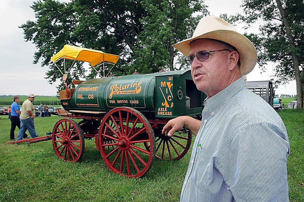 John Cross<br /> Mark Peterson, the son of Vern Peterson, talks about the rare, horse-drawn Standard Oil tanker that his father had restored and would auctioned off later in the day.