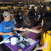Pat Christman <br /> A cashier at the Vikings Locker Room store in the Vikings Village returns change to a customer during Friday afternoon's training camp practice.