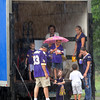Pat Christman <br /> Minnesota Vikings fans wait out a rain shower in the back of a truck during a tailgate party near Rasmussen Woods Thursday.