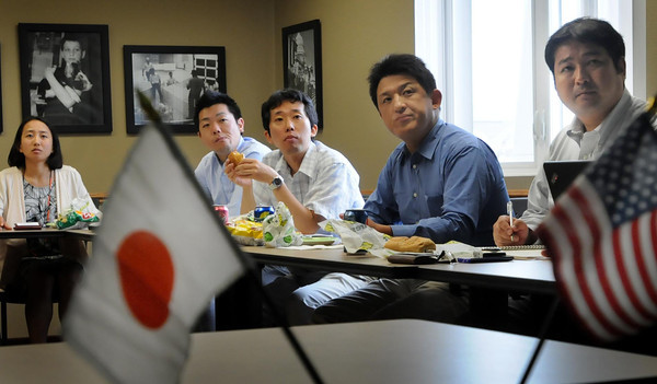 John Cross<br /> A delegation from Japan watches a presentation while lunching Tuesday with representatives from the Minnesota Pork Producers and the Minnesota Soybean Growers Assocation.