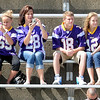 Pat Christman <br /> A family clad in Vikings jerseys watches the team practice Saturday morning at Blakeslee Stadium at MSU.