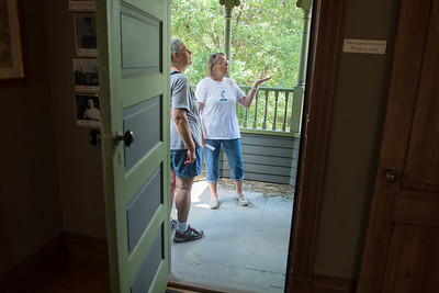 """Barb Saffert (center) shows Jan DeNoble the second floor porch during a tour of the Wanda Gag House in New Ulm. It was Saffert's first day giving tours. """"She knows a lot about the house,"""" said Mary Jean Janni, volunteer at the house for six years, """"She has studied and prepared so well."""" Photo by Jackson Forderer"""