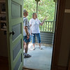 "Barb Saffert (center) shows Jan DeNoble the second floor porch during a tour of the Wanda Gag House in New Ulm. It was Saffert's first day giving tours. ""She knows a lot about the house,"" said Mary Jean Janni, volunteer at the house for six years, ""She has studied and prepared so well."" Photo by Jackson Forderer"