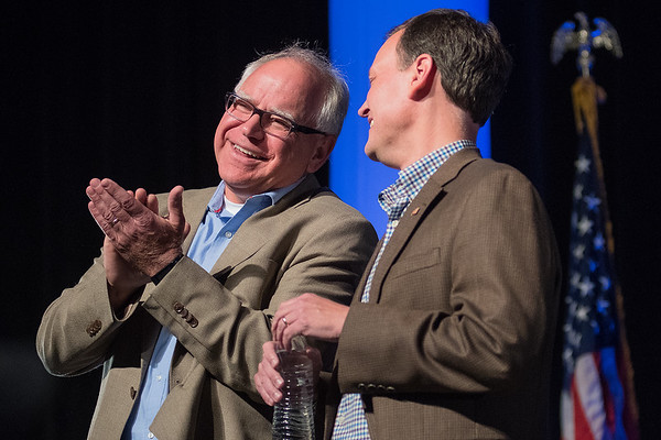 Democratic gubernatorial candidate Tim Walz (left) talks with Republican candidate Jeff Johnson (right) before the start of the gubernatorial forum held at the Verizon Performance Center on Thursday. Photo by Jackson Forderer