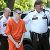 Waseca bombing suspect John LaDue is escorted into the Waseca County Courthouse for a hearing Wednesday. Photo by Pat Christman