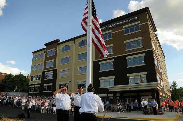 Several hundred people watch as members of Madison Lake Legion Post #269 present the flag during a dedication of the VINE Adult Community Center dedication and open house on Wednesday. Photo by John Cross