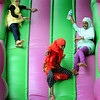Youngsters participating in the celebration of Eid al-Fitr, an Islamic holiday to mark the end of Ramadan, slide down an inflatable slide on Monday at Erlandson Park. The Mankato- area Islamic community gathered for prayer, food and games to mark the end of Ramadan, which is marked by daily fasting for 30 days from sunrise to sunset. Photo by John Cross