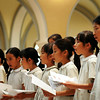 Members of a girl's choir from Notre Dame Elementary School, Kyoto, Japan sing on Tuesday in the chapel at Our Lady of Good Counsel. The award-winning 15-member group's school is sponsored by the School Sisters of Notre Dame. In addition to the musical stop, the youngsters had an opportunity to ride horses and go swimming at Madison Lake. Photos by John Cross