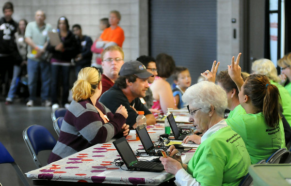 Patients register with screeners prior to receiving free dental care on Saturday during the MIssion of Mercy. Photo by John Cross