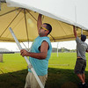 Scott Sandvig (left) and other members of a work crew from Mankato Tent and Awning erect one of several tents on Monday in preparation for the opening of the Minnesota Vikings pre-season training camp at Mankato State University. Photo by John Cross