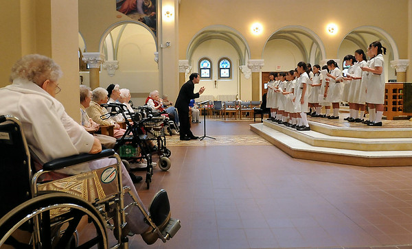 A choir from Notre Dame Elementary School in Kyoto, Japan perform in the chapel at Our Lady of Good Counsel on Tuesday. Photo by John Cross