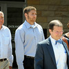 Philip Nelson (center) is flanked by his parents, Pat and Norma Nelson as he leaves the Blue Earth County Justice Center on Monday after a court appearance. In the foreground is defense attorney Jim Fleming. Nelson, a former starting quarterback for the University of Minnesota football team, has been charged with assaulting Isaac Kolstad in downtown Mankato on May 11, 2014. Photo by John Cross