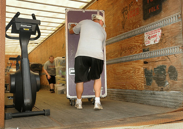 Vikings personnel unload training equipment from a semi-trailer on Monday for the team's pre-season training camp which opens at MSU later this week. Players are scheduled to arrive on Thursday. Photo by John Cross