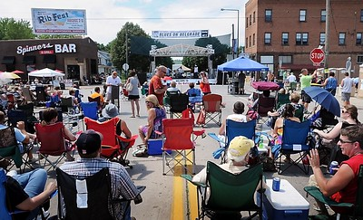 John Cross Music and conversation replaced the sounds of traffic Saturday as the 200 block of Belgrade Avenue was closed off for Blues on Belgrade.