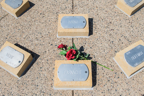 Roses were placed on David Fasnacht's name plate at the Vietnam War Memorial in Mankato as the Fasnacht family gathered to honor him on the 50th anniversary of his death. Photo by Jackson Forderer