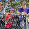 From left, Blake Ritzer, 15, Derek Stierlen, 11, and Jake Sizer, 13, show off their most prized autographs from this year's Vikings training camp outside of the practice fields on Thursday. Photo by Jackson Forderer
