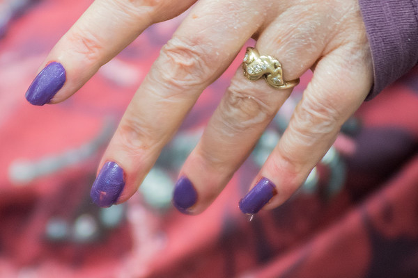 Diane Mrotz shows off her new Vikings themed manicure given to her by Rasmussen College staff on Friday at Hillcrest Rehabilitation Center. Kathy Dye, Theraputc Recreation Direction at Hillcrest, said just as many men as women received manicures from Rasmussen College staff. Photo by Jackson Forderer
