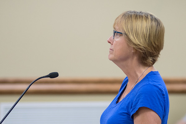 Former Taylor Library Director Lucy Lowry appears shocked after the North Mankato City Council prevented her from addressing her concerns about the city's work environment during a public comment period at a meeting Monday. Photo by Jackson Forderer