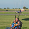 Sheldon Meyer (left) and Kasey Matejcek land in the grass at the Mankato Airport after skydiving Wednesday. Walk Mart employees skydived on Wednesday at 10,000 feet above Mankato. Photo by Jackson Forderer