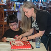 Faith Bergebin cuts a piece of cake for Charley Solano, 14, at the Wow! Zone on the 10th anniversary of his heart transplant. Charley had three surgeries before getting a heart transplant at Mayo Hospital on July 18, 2007. Photo by Jackson Forderer