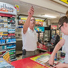 Jim Anderson, owner of Eagle Express in Eagle Lake, grabs a pack of cigarettes for a customer on Thursday. Anderson, who purchased the store 10 years ago, said he will maybe see a small jump in tobacco sales if Mankato raises the age to 21 to purchase tobacco. Photo by Jackson Forderer