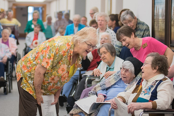 Sydelle McCabe (left), a pastoral care worker at Good Counsel, sings with other School Sisters of Notre Dame as a group of sisters caroled on the campus Thursday. Photo by Jackson Forderer