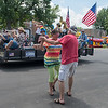 Christine Winter and Harvey Anderson from Eagle Lake dance in the street as the Schell's Hobo Band float goes by during the Paddlefish Days Parade held in Madison Lake on Saturday. Photo by Jackson Forderer
