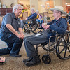 Gabe Stenzel (left) talks with Duane Burnett at Oaklawn Rehabilitation Center during Rasmussen College service day. Rasmussen college staff visited residents at four different senior care facilities in Mankato and Lake Crystal on Friday. Photo by Jackson Forderer