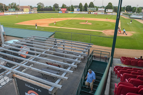 Ron Johnson (bottom), from Farmington, Minn. walks out of the main seating area behind home plate during a VFW baseball game between Mankato and Farmington. More than $3 million has been tentatively approved for upgrades to Franklin Rogers Park for new locker rooms and rest rooms, amongst other upgrades. Photo by Jackson Forderer