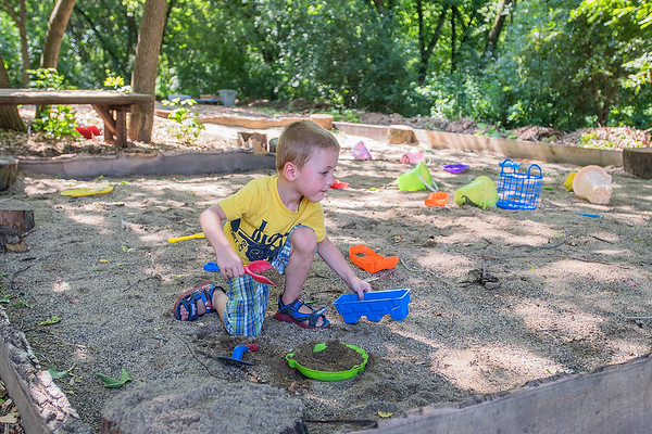 Brayden Stenzel, 4, plays in the large sandbox at the new Adventure Park in Eagle Lake on Thursday. The park is made from materials donated by local businesses. Photo by Jackson Forderer