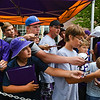 Blake Ritzer (left), 15, and Derek Stierlen (second from left), 11, wait to get an autograph from wide receiver Stefon Diggs as veteran Vikings reported to training camp on Wednesday. Photo by Jackson Forderer