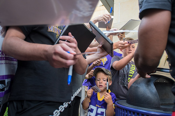 Russell Smith, 4, looks at a freshly signed autograph from Dalvin Cook of the Minnesota Vikings as the team's rookies arrived Sunday on the Minnesota State campus. Smith's mother said the family has been going to training camp every year and was sad that it was its last year in Mankato. Photo by Jackson Forderer