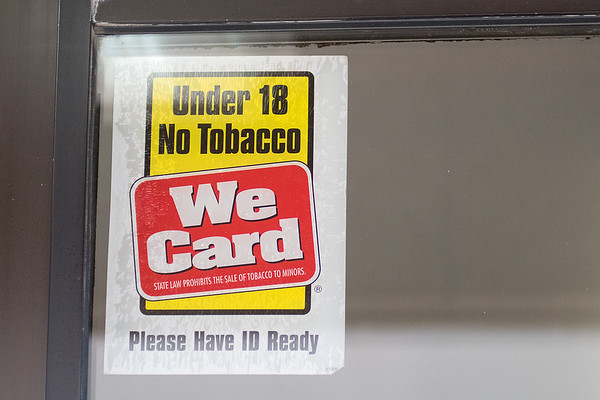 An ID sign on the outside of the Eagle Express in Eagle Lake. If Mankato raises the minimum age to buy tobacco products to 21 years old, the Eagle Express will be one of the closest convenience stores outside of Mankato that sells tobacco. Photo by Jackson Forderer