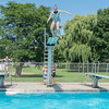 From left, Tegan Felber, 12, Hannah Anderson, 11, Kate Klinder, 11, coordinate themselves to jump off all three diving boards at the same time at Tourtellotte Pool on Friday. Next month, a feasibility report for repairing and enhancing the Tourtellotte Park municipal swimming pool will come to the council and is expected to suggest as much as $3.5 million in repairs and improvements. Photo by Jackson Forderer