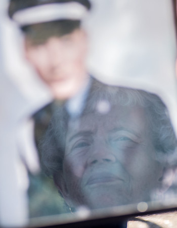 Joyce Castle, David Fasnacht's wife, is reflected in his military portrait. The Fasnacht family honored David on the 50th anniversary of his death in the Vietnam War at Vietnam Memorial Park. Photo by Jackson Forderer
