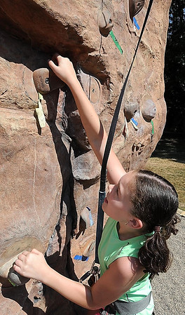 John Cross<br /> Emma Jeffrey searches for handholds as she scales the rock climbing wall at Minnesota State University during a rock climbing adventure camp, Monday.