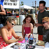 Sena Erhardt signs an autograph for her new fan, 10--year-old Mikayla Waskul, Mikayla's 7-year-old brother Elijah, and her dad, Dennis Waskul during Saturday's Riverfront Blues Festival at Riverfront Park.