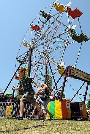 A boy races to the next ride at the North Mankato Fun Days carnival.