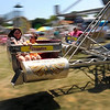 Kids streak by as they ride the Scrambler at North Mankato Fun Days.