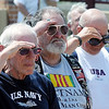John Cross<br /> Veterans salute as flags are raised during the dedication of the Veterans Memorial Place Wednesday.