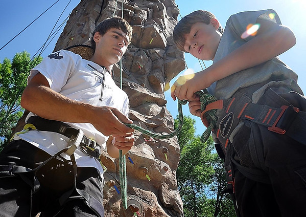 John Cross<br /> Novice rock climber Anders Thro gets some knot-tying pointers from Pete Hunt before attempting to scale the rock climbing wall at Minnesota State University, Monday. Thro was attending a rock climbing camp co-sponsored by the colleges Adventure Education Program and Community Education. The camp concludes Thursday.