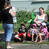 Fron left, Aidan, Maggie and Holly Klammer and their mother Emily have their picture taken by their cousin Anna Pfeiffer before the start of Saturday's North Mankato Fun Days parade.